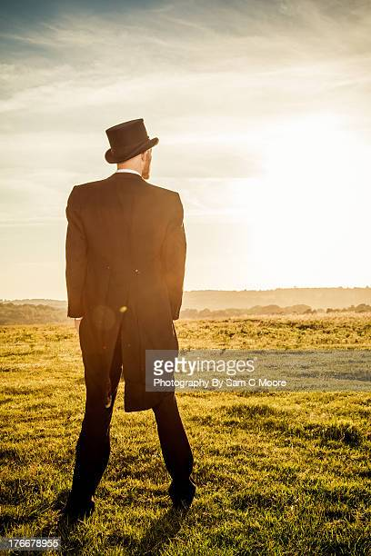 Man dressed in Top and Tails in a Field