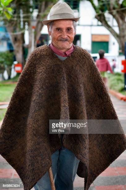 A man dressed in typical poncho of the area Central square of Finlandia Quindio Colombia