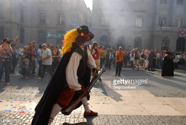 a man dressed in vintage traditional clothing, fires a blunderbuss during la mercè festival in barcelona - blunderbuss stock pictures, royalty-free photos & images