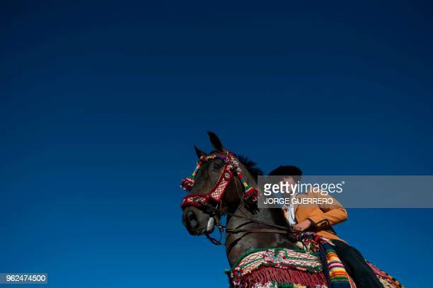 A man dressed like a Bandolero bandit takes part in the reenactment of a battle of the Spanish War of Independence against France in Ronda southern...