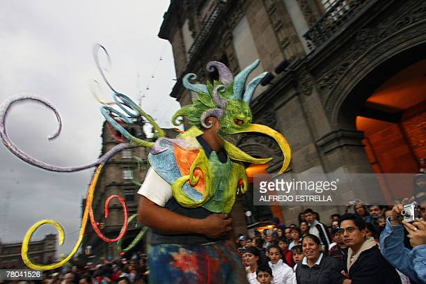 A man dressed like an Alebrije parades during the first Parade 'La Noche de los Alebrijes' in Mexico City 20 October 2007 The Alebrije is a Mexican...