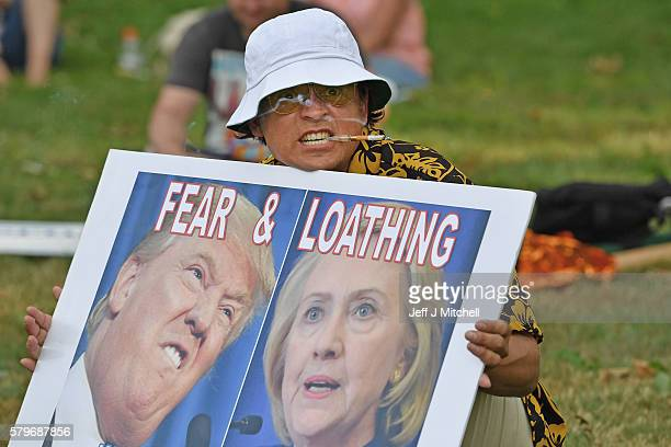 A man dressed like author Hunter S Thompson holds a sign before the start of the Democratic National Convention on July 24 2016 in Philadelphia...