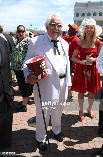 Man dressed like Col Sanders stands in the Paddock area durinng the 134th running of the Kentucky Derby on May 3, 2008 at Churchill Downs in...