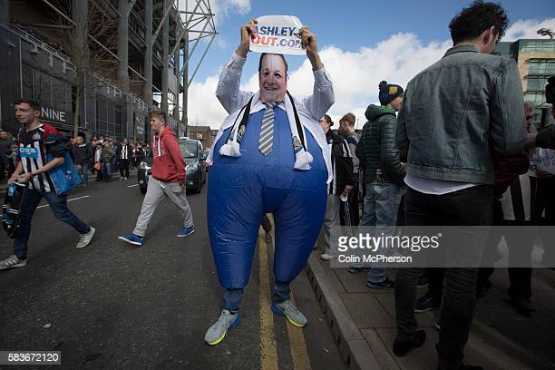 A man dressed to look like club owner Mike Ashley at a demonstration at the Gallowgate end of the stadium before Newcastle United host Tottenham...