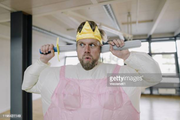 man dressed up as a ballerina with toy sword in office - mask disguise stock pictures, royalty-free photos & images