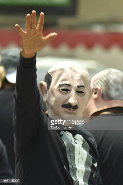A man dressed up as Carlos Salinas of The Mafia of Power team poses during the protest match between Mafia del Poder and Morena Party at Alameda...