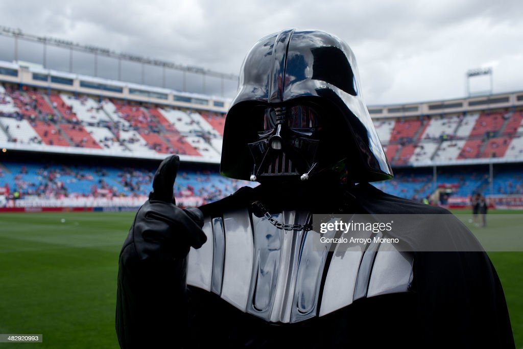 A man dressed up as Darth Vader of Stars War film walks on the pitch prior to start the La Liga match between Club Atletico de Madrid and Villarreal CF at Vicente Calderon Stadium on April 5, 2014 in Madrid, Spain.