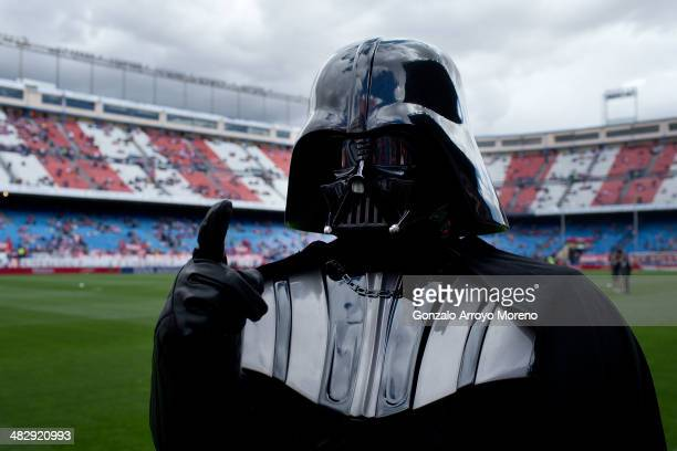Man dressed up as Darth Vader of Stars War film walks on the pitch prior to start the La Liga match between Club Atletico de Madrid and Villarreal CF...