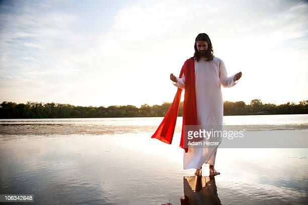 man dressed up as jesus on water. - jesus imagens e fotografias de stock