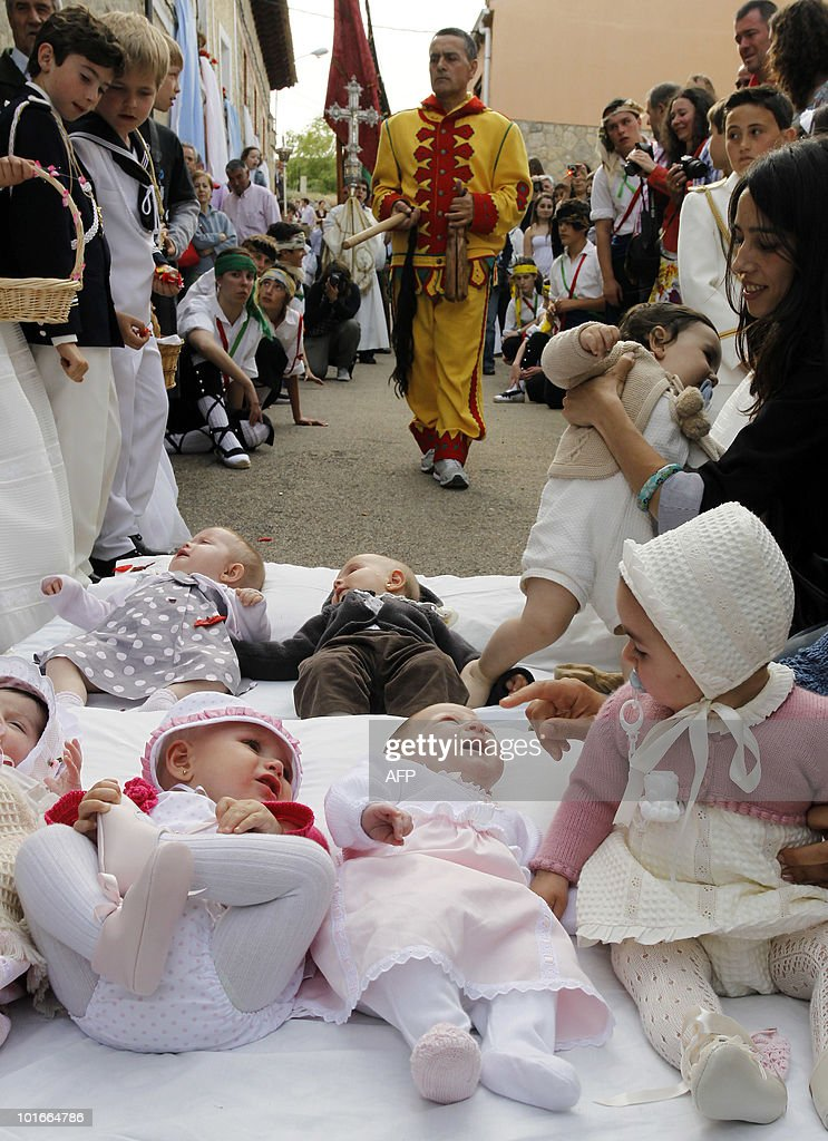 A man dressed up as the devil approaches babies lying on a mattress in the street during the 'El Salto del Colacho' (the jump of the devil) to mark the Corpus Christi feast in Castrillo de Murcia, near Burgos, on June 6, 2010.