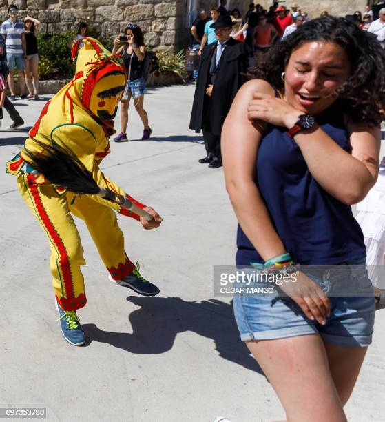 A man dressed up as the devil chases a participant during 'El Colacho' the 'baby jumping festival' in the village of Castrillo de Murcia near Burgos...