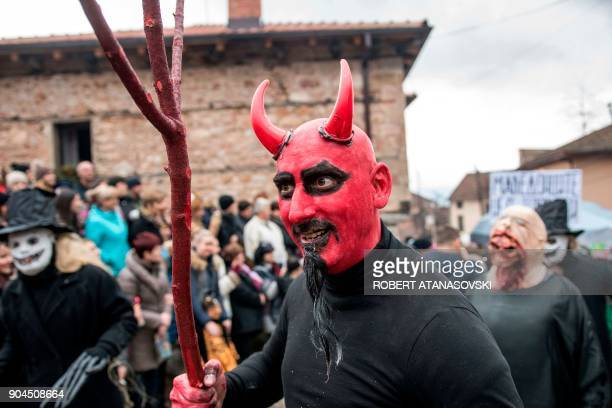 A man dressed up as the Devil takes part in a carnival through the southwestern Macedonias village of Vevcani on January 13 2018 The Vevcani carnival...