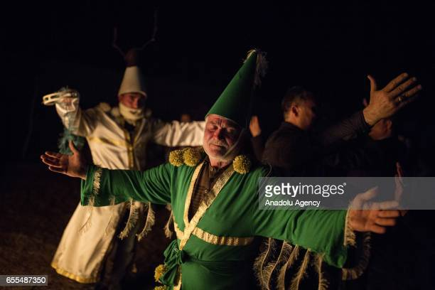 A man dressed up as the Green Kosa who is believed to prevent famine and unhappiness and bring plentifulness and happiness for the whole year in case...