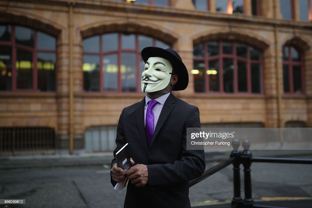 A man dressed up in a mask takes part in anti-Brexit and anti-austerity protests as the Conservative party annual conference gets underway at Manchester Central on October 1, 2017 in Manchester, England. Five-hundred thousand people are expected to take part in the protests with police mounting an unprecedented security operation of a thousand officers and extra armed police to protect Conservative party conference delegates.