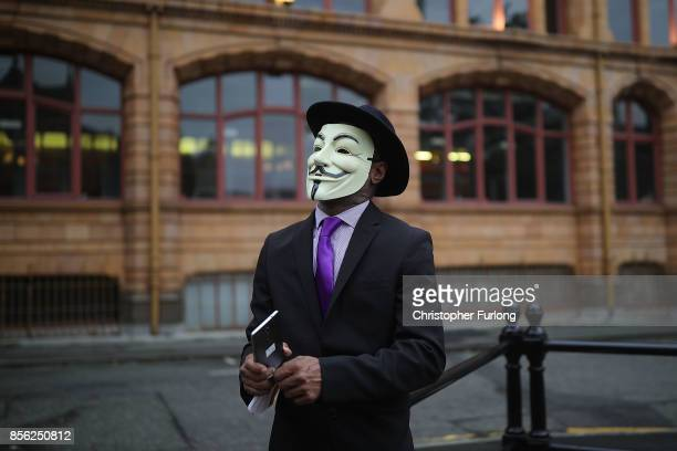 A man dressed up in a mask takes part in antiBrexit and antiausterity protests as the Conservative party annual conference gets underway at...