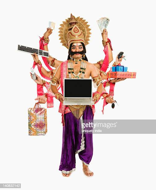 Man dressed-up as Ravana the demon king holding gifts