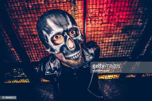 man dressed-up for halloween with skull mask and dramatic make-up - dungeon stock photos and pictures