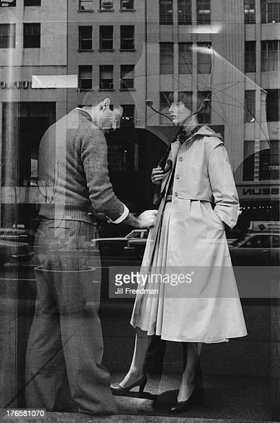 A man dresses a mannequin in the window of Bergdorf Goodman 5th Avenue New York City circa 1980