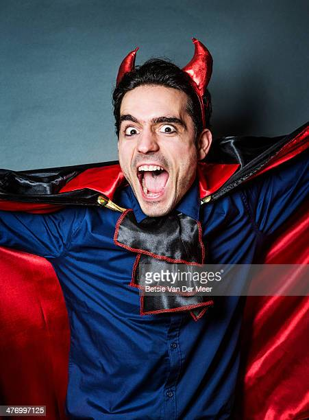 man dresses as devil for halloween. - devil costume stock photos and pictures