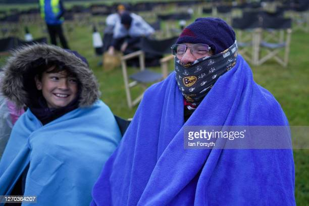 Man dresses for the weather as members of the public attend a screening of The Greatest Showman during the Luna Cinema movie experience at Castle...