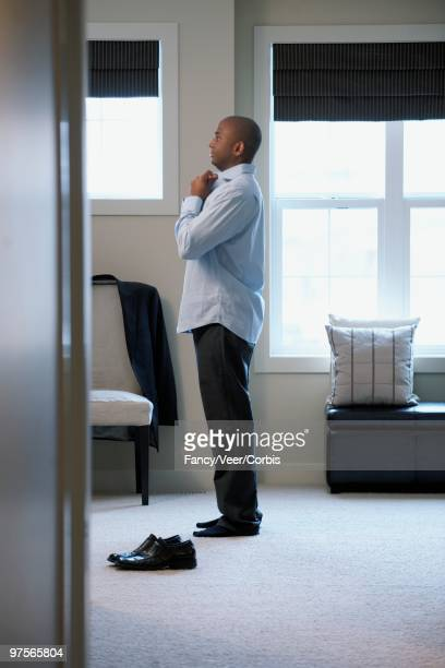 man dressing - adjust socks stock pictures, royalty-free photos & images
