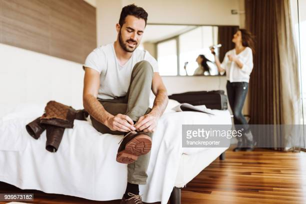 man dressing up in the hotel room - getting dressed stock pictures, royalty-free photos & images