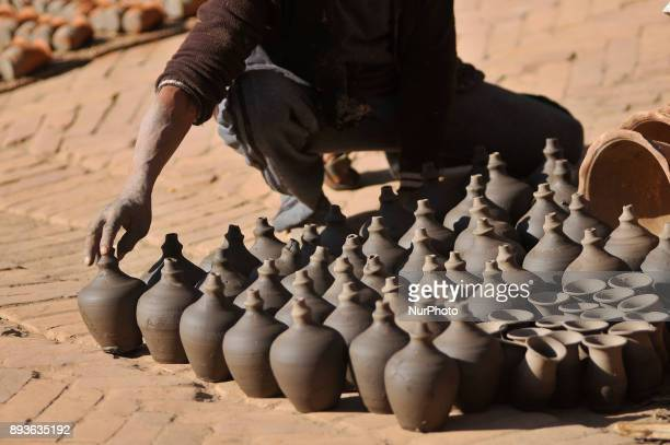 A man dried Piggy Bank clay pot on his workshop at Pottery Square Bhaktapur Nepal on Friday December 15 2017 Nepalese Potter works on their small...