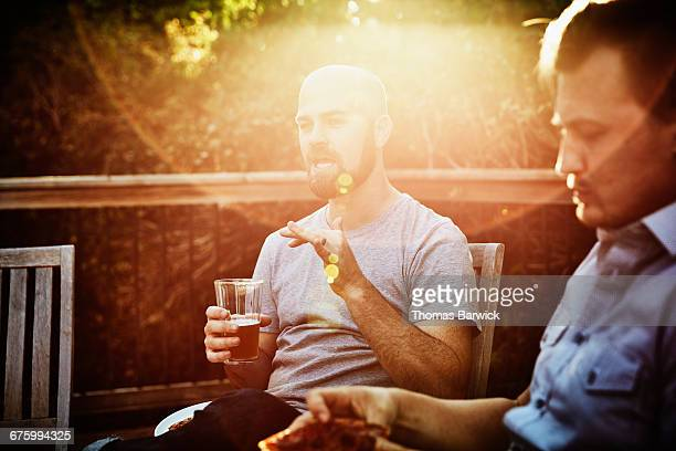 man drinking a beer in discussion with friends - responsibility stock pictures, royalty-free photos & images