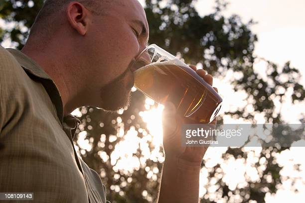 Man drinking a beer.
