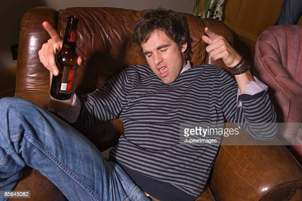 Man drinking beer at party