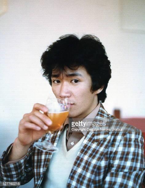 Man drinking beer in wineglass