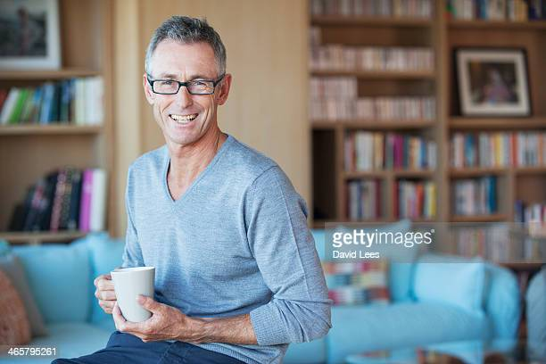Man drinking coffee in living room