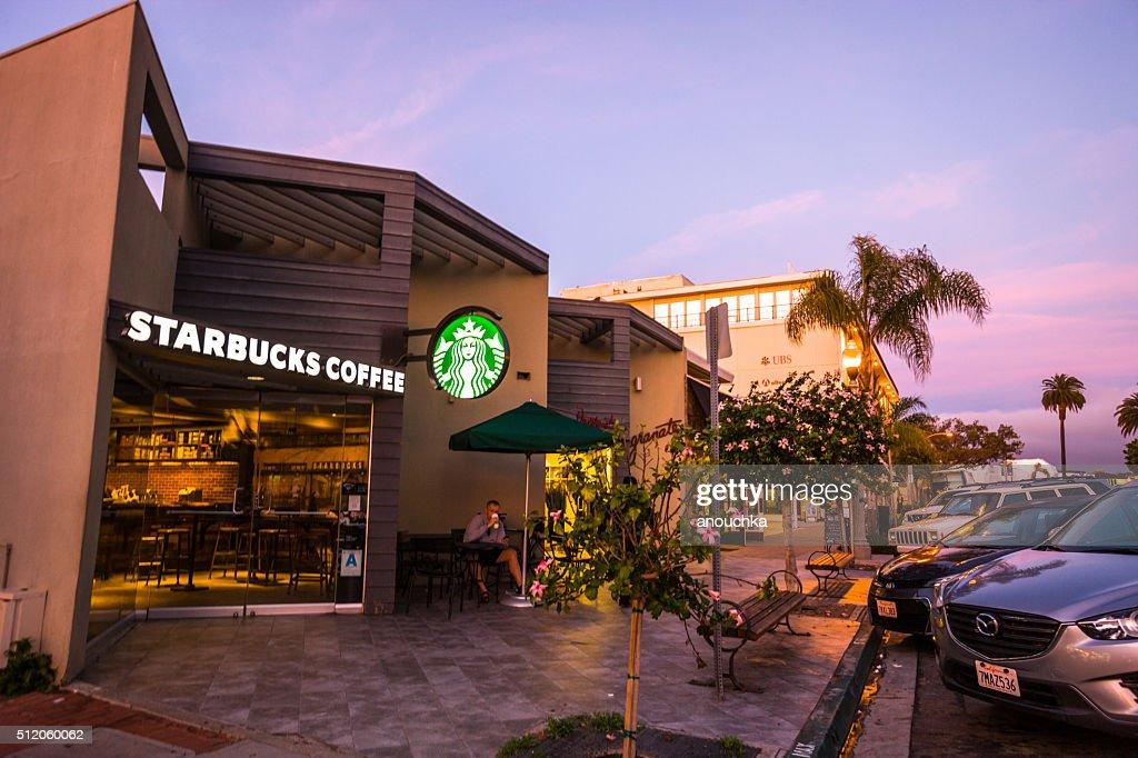 Man drinking coffee in Starbucks, La Jolla, USA : Stock Photo