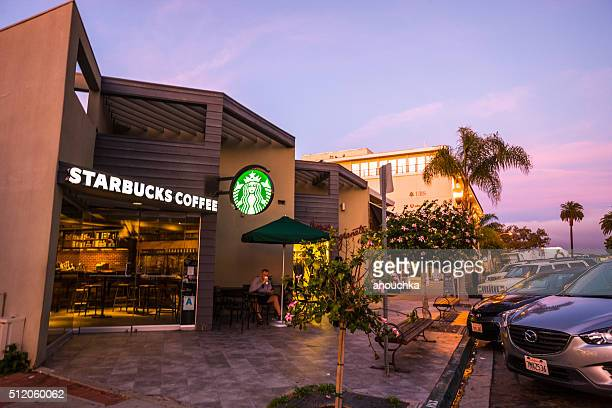 Man drinking coffee in Starbucks, La Jolla, USA