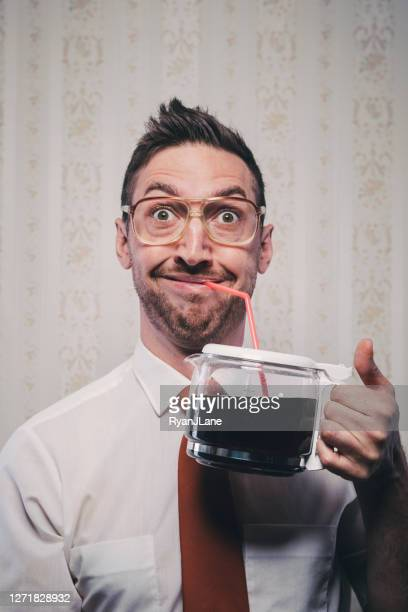 man drinking directly out of coffee pot with straw - funny wake up stock pictures, royalty-free photos & images