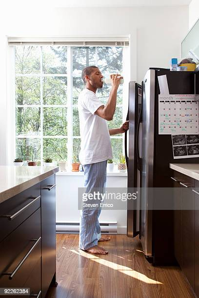 man drinking from milk container - barefoot black men stock pictures, royalty-free photos & images