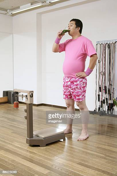 a man drinking green juice - metabolic syndrome stock pictures, royalty-free photos & images