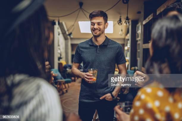 Man drinking iced coffee