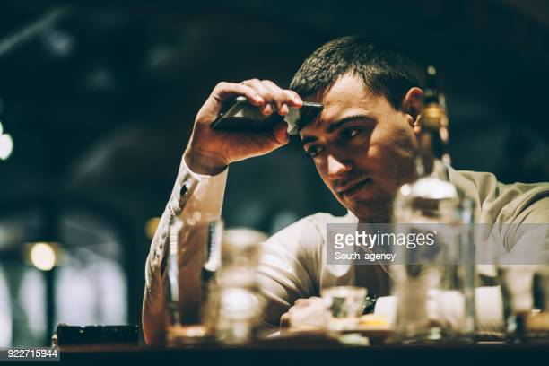 man drinking in nightclub - hangover after party stock pictures, royalty-free photos & images