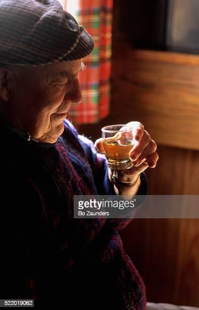 Man Drinking Malt Whiskey