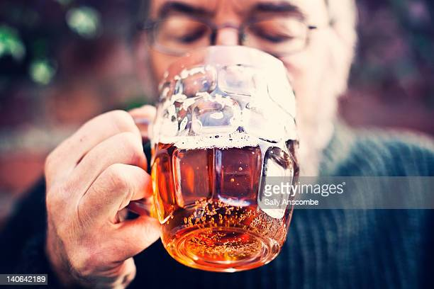 man drinking pint of beer - ale stock pictures, royalty-free photos & images