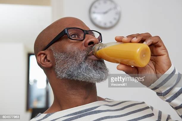 Man drinking smoothie