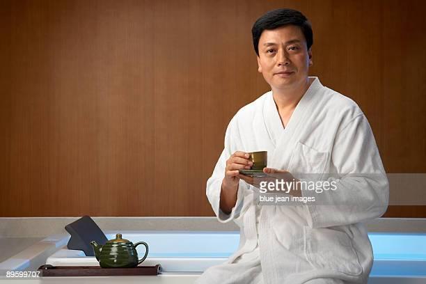Man drinking tea at a spa