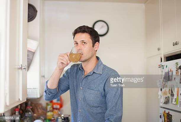 Man drinking tea at home