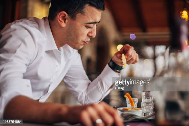 man drinking tequila - sour taste stock pictures, royalty-free photos & images