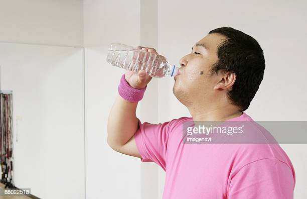 a man drinking water - metabolic syndrome stock pictures, royalty-free photos & images