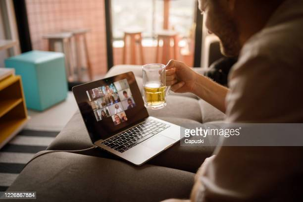 man drinking with friends on social distance - happy hour stock pictures, royalty-free photos & images