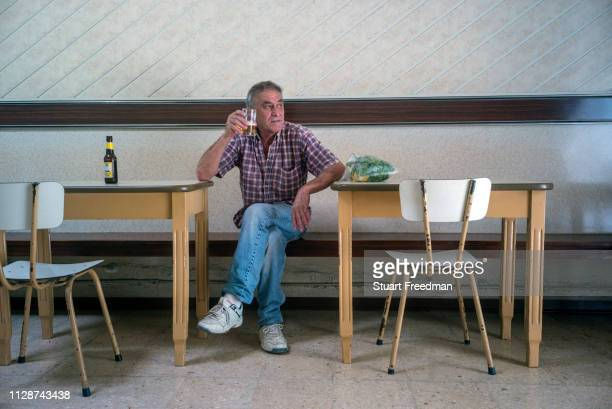 A man drinks a beer in the Coney Island Bar in Victoria the capital of the island of Gozo in Malta The bar opened in the 1960s is a tiny but classic...