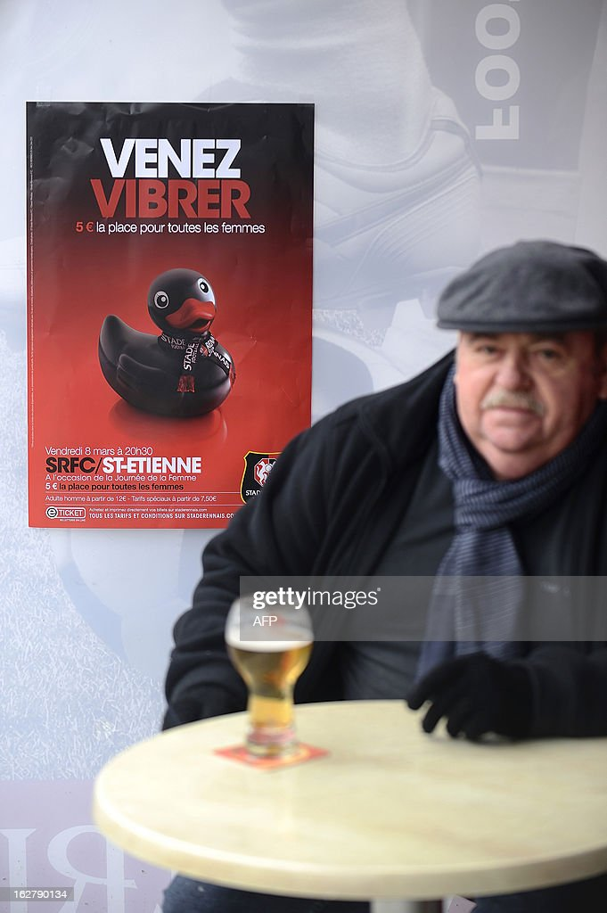 A man drinks a beer infront of an advertising poster of the Stade Rennais football club showing a sex toy and reading 'come to vibrate' on February 27, 2013 in Rennes, western France. Top-flight French football club Rennes risked drawing the wrath of the feminist movement by launching an advertising campaign based at female fans featuring a sex toy with the logo 'Venez vibrer' (come to vibrate).