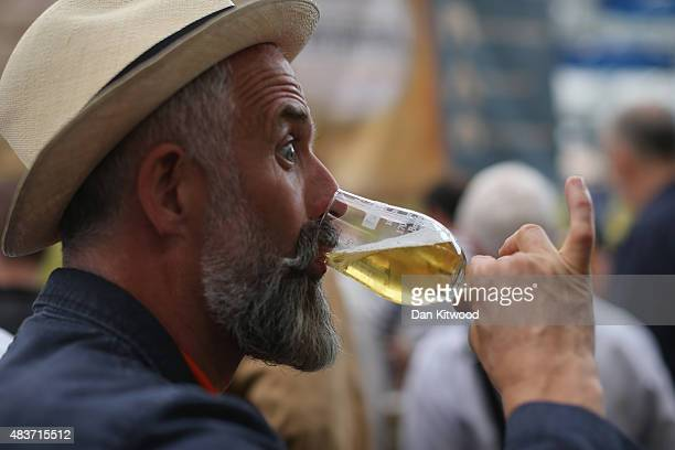 Man drinks a glass of Ale at the CAMRA Great British Beer festival at Olympia London exhibition centre on August 12, 2015 in London, England. The...